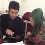 FHI 360 field staff in Erbil, Iraq, provide technical support to participants as part of the Women's Digital Literacy and English program